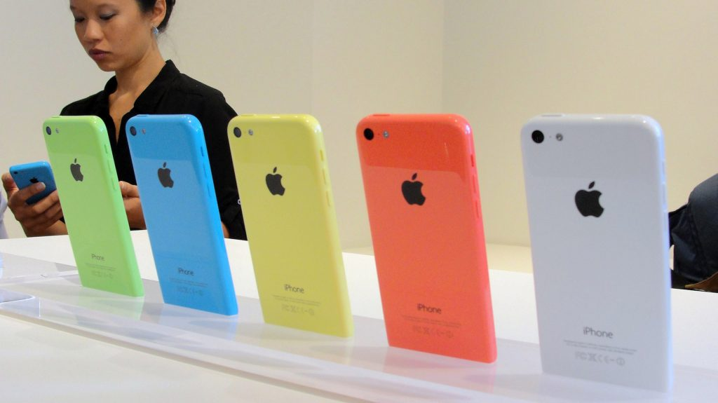 """The new lower-cost iPhone 5C will debut in a set of lively colors at an iPhone event at Apple's headquarters in Silicon Valley on September 10, 2013 in Cupertino, California. Apple unveiled two new iPhones on Tuesday in its bid to expand its share of the smartphone market, including one as low as $99 with a US carrier contract. """"The business has become so large that this year we are going to replace the iPhone 5 and we are going to replace it with two new designs,"""" Apple chief Tim Cook announced at the company's Silicon Valley headquarters. Apple will begin taking orders on Friday, and on September 20 the two devices will go on sale in the United States, Australia, Britain, China, France, Germany, Japan and Singapore. AFP PHOTO/GLENN CHAPMAN (Photo credit should read GLENN CHAPMAN/AFP/Getty Images)"""