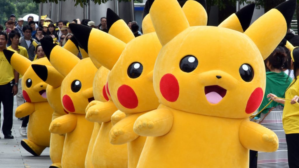 "Dozens of Pikachu characters, the famous character of Nintendo's videogame software Pokemon, march at the Landmark Plaza shopping mall in Yokohama, suburban Tokyo on August 13, 2015.  The Pikachu mascots walk around daily to attract summer vacationers as a part of the ""Pikachu Outbreak"" event through the weekend.     AFP PHOTO / Yoshikazu TSUNO        (Photo credit should read YOSHIKAZU TSUNO/AFP/Getty Images)"